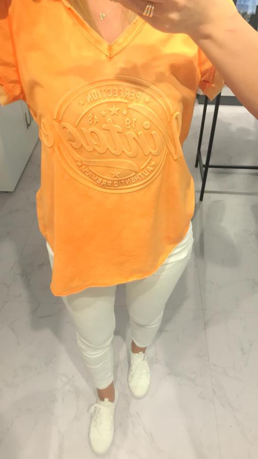 Cudownie lekka pomarańczowa bluzka z napisem