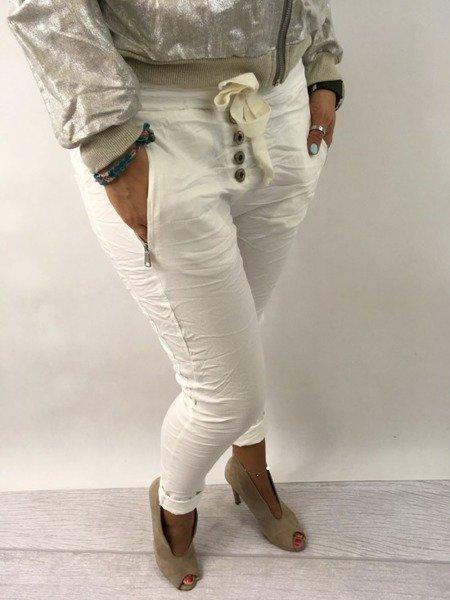 Spodnie białe guzik zamek