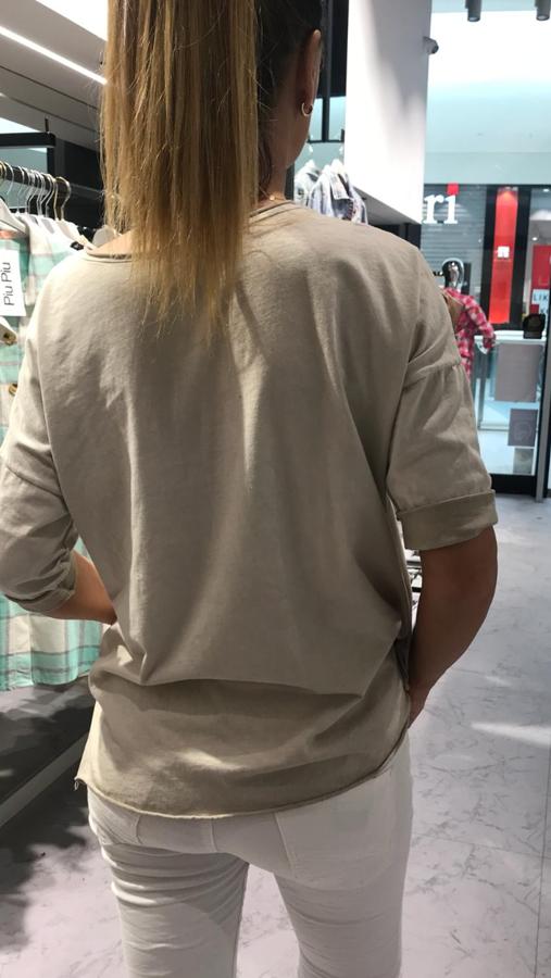 Super gatunkowa beżowa bluzka z motywem orła
